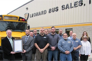 The Saratoga County (N.Y.) Board of Supervisors honored Leonard Bus Sales for 50 years in business on Dec. 21. Shown here left to right are board of supervisors Chairman Matthew Veitch, Leonard Bus Sales Vice President Jon Leonard, and Saratoga Springs customer support facility staff members.