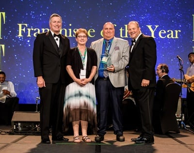 Greg Kimberlin (third from left) was one of three to receive franchisee of the year honors. He is shown with (from left) Jim Bull, Tammy Kimberlin and John Kairys.
