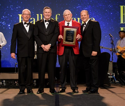 Bill Walker (third from left) is the newest member of the Big O Tires Hall of Fame. He is pictured with Big O Tires executives (from left): Rick O'Neil, Jim Bull and John Kairys.