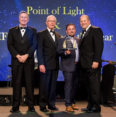 Chris Monteverde (third from left) received the Point of Light and IFA awards. He is shown with (from left) Jim Bull, Rick O'Neil and John Kairys.