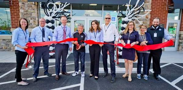 Racing legend Mario Andretti cut the ribbon for new Virginia Tire & Auto store in Chesterfield. Next to Andretta are CEO Mike Holmes and President Julie Holmes. Company founders Myron Boncarosky (fourth from right) and Carole Boncarosky (second from right) also attended.