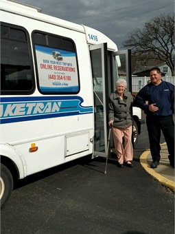 Willowick senior Reta King, 95, uses Dial-a-Ride to get to Willowick Senior Center accompanied by Laketran driver Martin Mihalik.