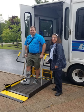 A construction accident at his home left Laketran CEO Ben Capelle (shown left with driver Patty Donner) with a severely broken leg and unable to drive for over two months, becoming completely reliant on public transportation. Laketran