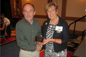 At the School Bus Driver International Safety Competition, Larry Hannon of Pennsylvania placed first in the conventional category — his ninth win. He is seen here with outgoing NSTA President Magda Dimmendaal.