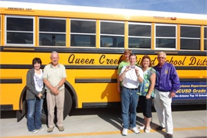 Author Bill Lehman (third from right) holds his CDL. Also pictured are, from left, Marsha Stones, lead trainer; Jim Murphy, trainer; Carolyn Gaebler, trainer and route coordinator; Chanie Passerby, fleet service assistant and trainer; and Edd Hennerley, director of transportation.