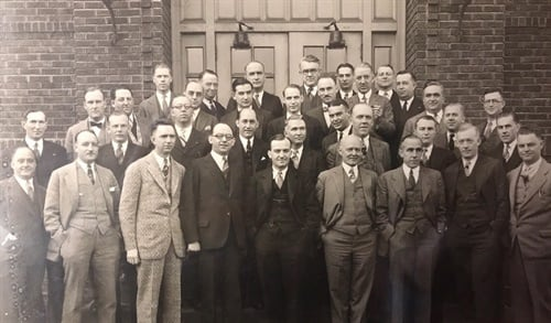 General Tire & Rubber Co. executives urged Leon Lewis to open a store of his own. In 1919 he did so, and attended his first General Tire dealer meeting. He is pictured in the third row from the bottom, second from the right.