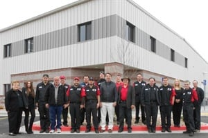 The Lewis Bus Group staff poses in front of the Thomas Built Buses dealership's new, larger location.
