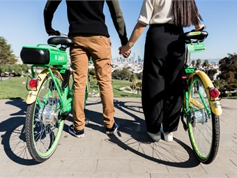 Using geofencing technology, dockless scooter and bike operators will be required to slow their devices down to eight miles per hour in designated high-pedestrian traffic zones around the city, per proposed regulations. Photo: Lime