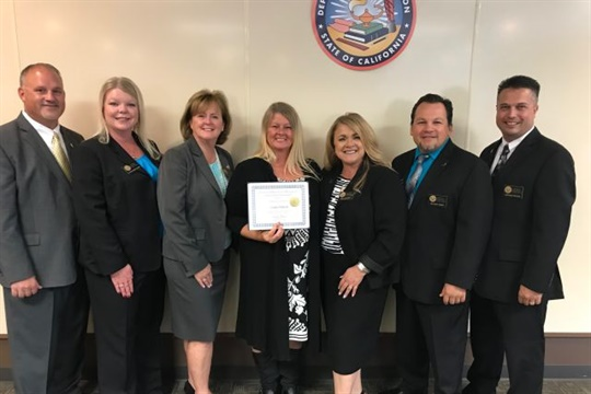 Linda Titford (center) is one of Student Transportation Inc.'s new California state-certified instructors. She is seen here with representatives from the California Department of Education.