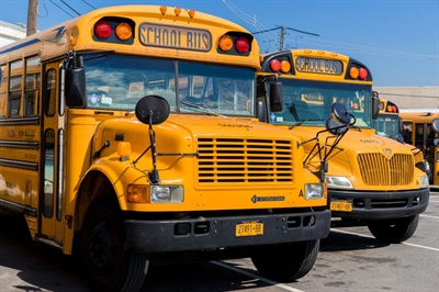 School bus contractor leader Corey Muirhead details the dire situation school bus companies are in due to COVID-19-spurred school closures and some districts not paying them. Shown here are buses from his company, Logan Bus and Affiliates. Photo courtesy Corey Muirhead