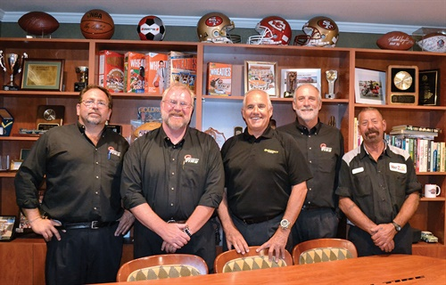 Redwood General Tire is led by its veteran team, from left, service manager Carlos Perez, 27 years; commercial road service manager Kurt Boegner, 30 years; Barbara; store manager Denny Reiser, 24 years; and lead technician Joe Della Chiesa, 30 years.