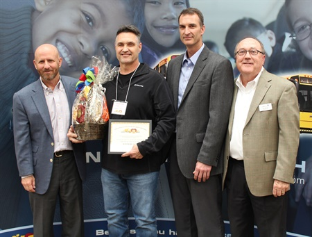 David Black (second from left) of Trussville City Schools in Alabama was named Driver of the Year during the Transportation South event. Also pictured: Bucky Law (left) of Transportation South, Chad Carpenter of the Alabama State Department of Education, and Joe Lightsey of Transportation South.