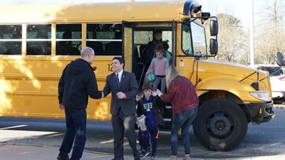 North Carolina State Superintendent Mark Johnson, shown right, joined the celebration of student transporters with a visit to Salem Elementary School in Apex, where he rode a school bus with students, greeted bus drivers, and attended a breakfast held in their honor.