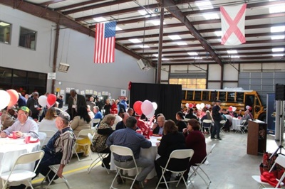 "Alabama-based school bus company Transportation South Inc. hosted its 10th annual ""Love the Bus"" celebration on Feb. 13."