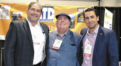 Luis Navarro, right, and his Tersa Corp. teammates came from Mexico to attend the show. On the left, Raul Bejarano is director of real estate, and Rodrigo Valle, center, is president of the tire dealership based in Tijuana.