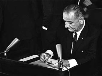 President Lyndon B. Johnson signed the Urban Mass Transportation Act in 1964. Photo: FTA