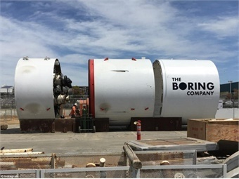 "Godot, The Boring Co.'s tunnel boring machine (TBM) at the SpaceX headquarters in Hawthorne, California. The machine is named after the Beckett play, ""Waiting for Gadot."" Photo via The Boring Co."