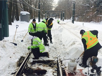 MBTA Crews work to clear station areas and tracks. MBTA