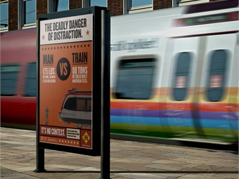 "MBTA platform poster for 2014 ""See Tracks, Think Train"" campaign. Photo: OLI"