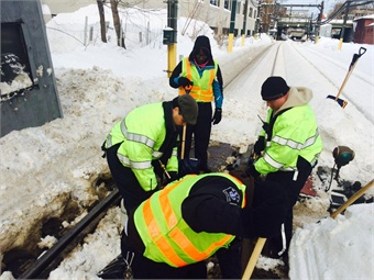MBTA workers work to clear switches from Green Line.