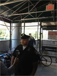 The cutout (shown in background) is actually a picture of real MBTA Officer David Silen.