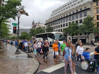 The Washington, D.C. march, part of NCIL's 30th annual conference, draws more than 1,000 people with disabilities, disability advocates and allies, members of Congress, and government officials. Photo: MCI