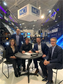 Mike Cassidy (center), Principal of the Cassidy Group, signs battery-electric demonstration agreement on behalf of Coach Atlantic with MCI's executives from left; Patricia Ziska, JP Nadeau, Ian Smart and Patrick Scully, during UMA EXPO in Nashville,Tenn. MCI