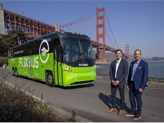 Michael Kahn, head of business development at FlixBus USA (left) and Brent Maitland, MCI's VP, marketing and product planning, at an event in San Francisco to commemorate the testing of MCI's all-electric motorcoach. MCI