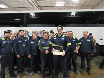 """When Grammy Award winner Andrew Craig Brown returned to work, a cake and another """"Grammy"""" created from bus parts by fellow technician Pawel Fulat, who presented it at MCI's very own award celebration.MCI"""
