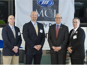 Vice President of MCI Public Sector Tom Wagner, second from left, is joined by North Dakota Commerce Department Commissioner Alan Anderson, from left, Rep. Kevin Cramer, R-N.D., and Ron Storey, plant manager at the MCI plant in Pembina, N.D.