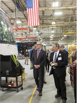 Rep. Kevin Cramer, R-N.D. (shown left), touredthe MCI bus assembly plant in Pembina, N.D. during APTA's Stand Up for Transportation day on April 9, 2015. Cramer spoke about the need for a long-term transportation bill during the event.