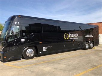 MCI's Livery Edition for Premiere Transportation adds black leather diamond stitch seating for 56 passengers, woodgrain flooring, and power outlets with USB ports.