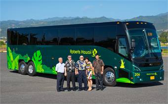 Roberts Hawaii's (left to right) Percy Higashi, Scott Iwamoto, Robert Iwamoto, Arlene Iwamoto and Chad Iwamoto with one of the company's 25 new MCI J4500 coaches.
