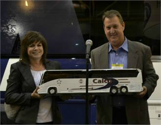 Callen Hotard, president of Calco Travel, and his wife Coleen, vice president, were honored by MCI for their dedication to green transportation and raising service standards in the Gulf Region.