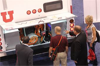 Showgoers take an up-close look at CCW's electric bus offering.