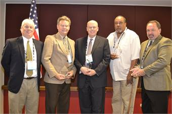 The MSBMA's Scott Reston (left) honored transit agencies with the largest number of mid-sized vehicles in their fleets.