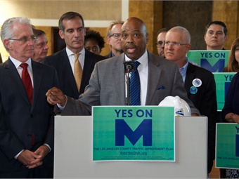 Measure M will bring the L.A. region 40 transportation projects in 40 years, according to Metro CEO Phil Washington (shown speaking at a press event).
