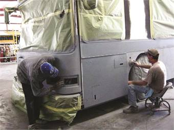 CoachCrafters technicians perform body and paint repairs in the company's 22,000 square foot facility in Tavares, Fla.
