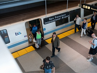 A rendering of passengers boarding BART at San Francisco International Airport Station.