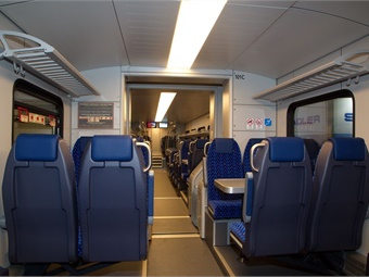 TEXRail vehicle amenities include work tables, lap trays, a quiet car, level boarding, and overhead storage for bags.