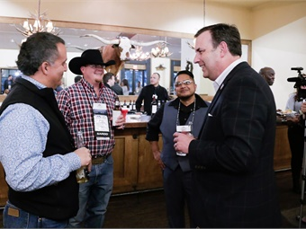 UMA President/CEO Stacy Tetschner (far right) talks to members during a networking reception at the Buckhorn Saloon. David Braun