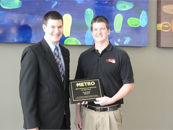 In January, GM David Moody (on left) and Asst. GM Jonathan Moody accepted METRO's Motorcoach Operator ofthe Year Award.