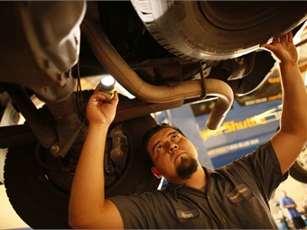 Maintenance technician working on a propane autogas van.