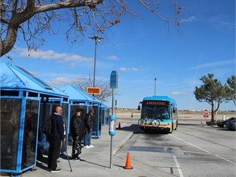 An Antelope Valley Transit Authority bus approaching the transfer center equipped with a WAVE charging pad embedded in the asphalt.