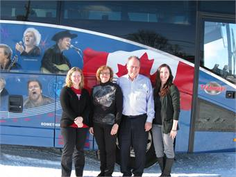 Lorna and Larry Hundt, shown here in the middle with daughters Andrea, left, and Michelle, started the tour operation in 1984.