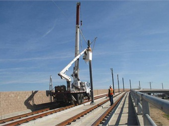 Installation of overhead catenary system on the light rail bridge over Cosumnes River Boulevard.