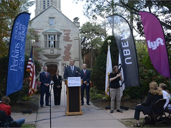 The MBTA's pilot with Uber and Lyft allowed paratransit users to take 28% more trips. Gov. Charlie Baker is pictured announcing program at the Perkins School for the Blind.