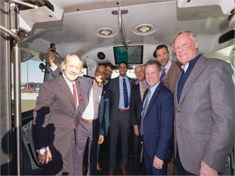 Denver RTD CEO/GM Dave Genova (third from right) is joined by stakeholders during the January 2019 launch of the agency's driverless shuttle pilot program.
