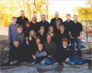 With four active third-generation family members, including President Scott Hays (bottom row, fourth from left), REI continues to be a family-owned and run company.