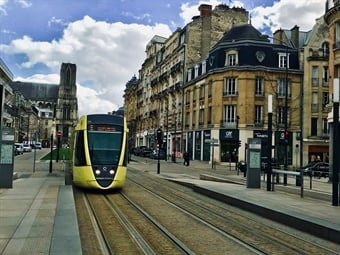 An Alstom Citadis light rail tram making its way through the city center of Reims, France.